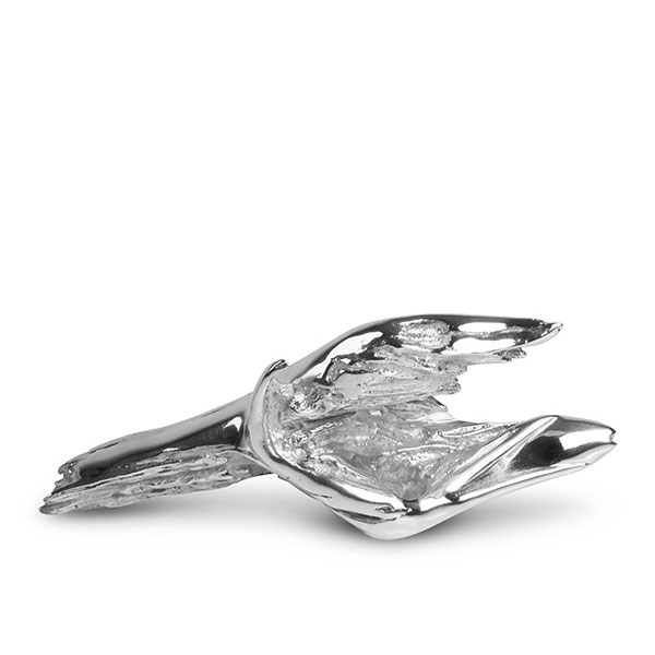 Miniature titled Gotcha! in sterling silver. a bird is catching a fish, not strictly figurative. The wings of the bird, the open beak and the fish are all emerging out of the waves of the water.