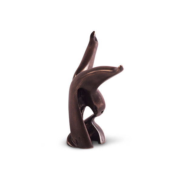 Miniature titled Catch of the Day in bronze, dark brown in color. A bird with spread wings, head and beak.