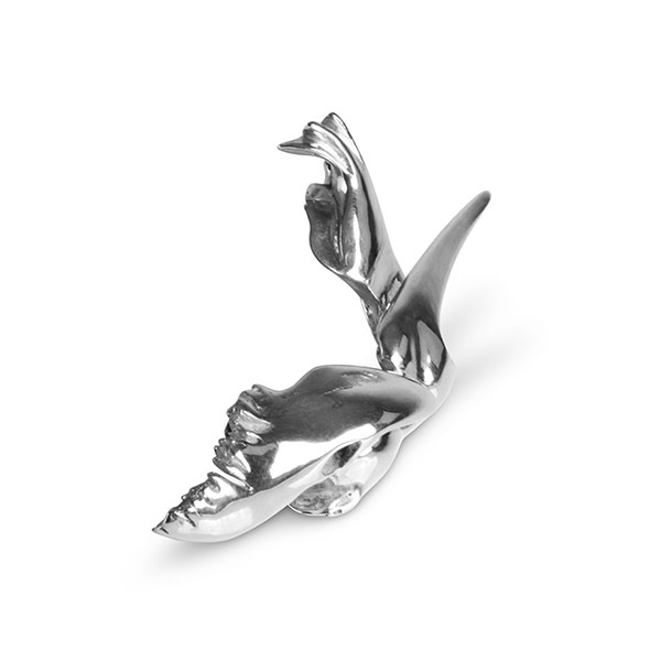 Miniature titled Swamp Seraph is made of sterling silver and it shows a powerful bird seated with strong wings and a long beak. Side view.
