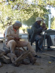 Karena Xlamkwa and Bashi Mokweni working on their wood carving pieces